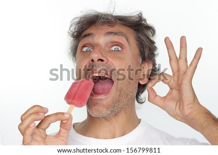 happy man holding red popsicle over white background - stock photo