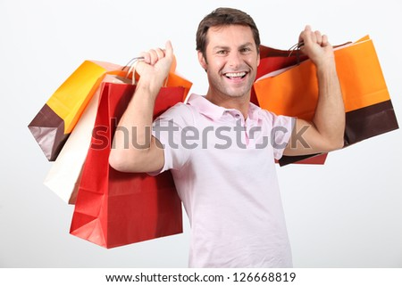 happy man holding shopping bags - stock photo