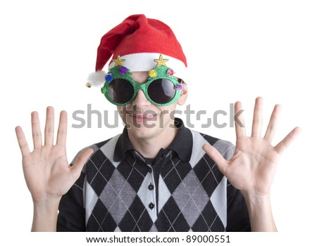 Happy man in Christmas party glasses and hat with hands up