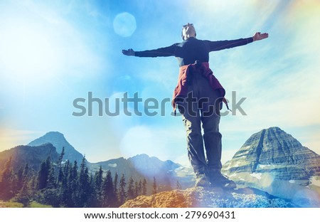 Happy man in mountains - stock photo