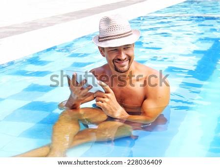 happy man in pool - stock photo