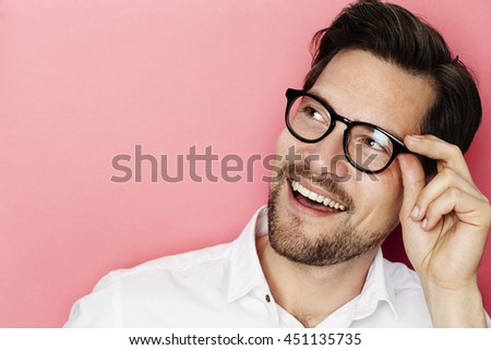 Happy man in spectacles looking away - stock photo