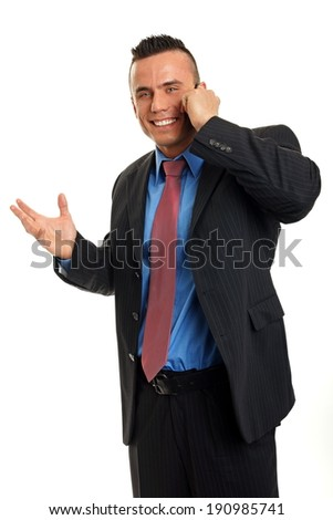 Happy man in suit talks into mobile phone