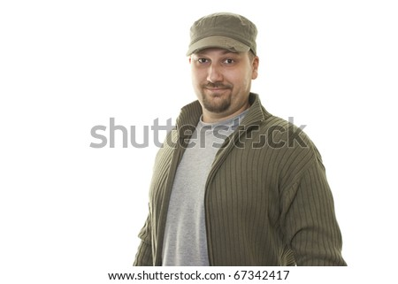 happy man in sweater and cap posing - stock photo
