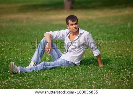 Happy man in the park - stock photo