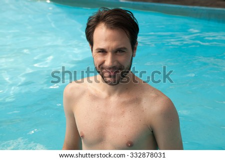 Happy man in the pool