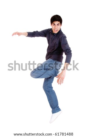 Happy man jumping over white background