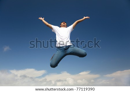 Happy man jumping with  blue sky background - stock photo