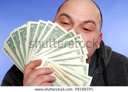 happy man kisses some dollar bills - stock photo