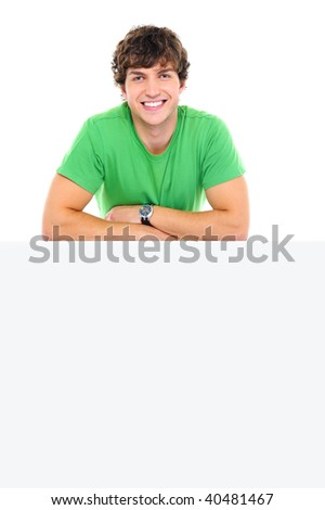 Happy man lean on the white banner - over white background - stock photo
