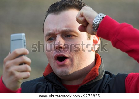 Happy man looking at a mobile phone - stock photo