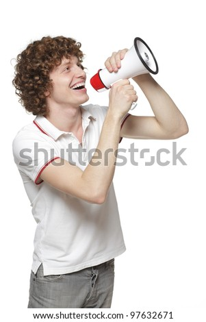 Happy man making announcement over a megaphone against white background