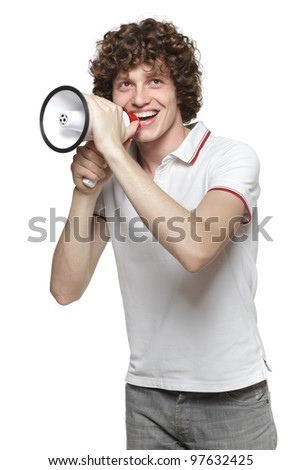 Happy man making announcement over a megaphone, looking upwards against white background - stock photo