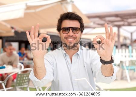 Happy man okay gesture - stock photo