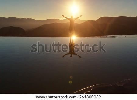 Happy man on beach - stock photo