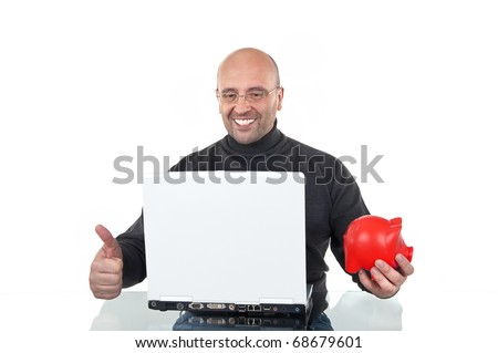 Happy man online-banking with a piggy-bank in his hand