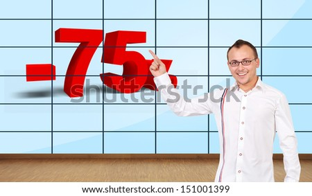 happy man pointing at discount on plasma wall - stock photo