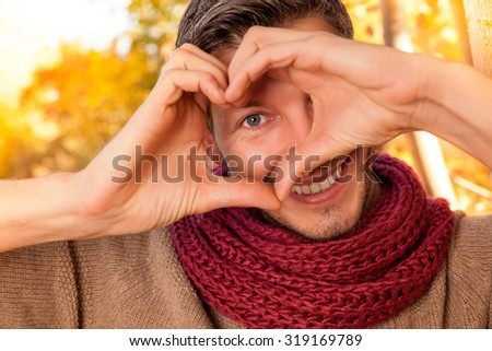 happy man portrait making heart concept sign - stock photo
