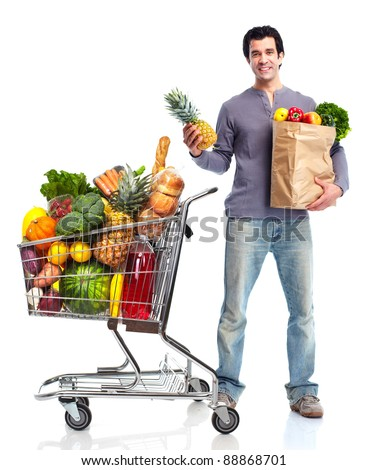 Happy man shopping in supermarket grocery . Isolated over white background. - stock photo