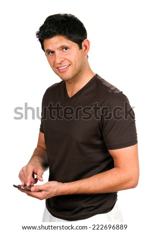Happy man smiles as he sends a texting message on his smartphone. - stock photo