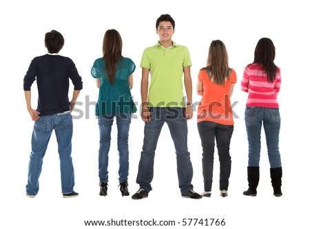 Happy man smiling to the camera with a group facing backwards - isolated - stock photo