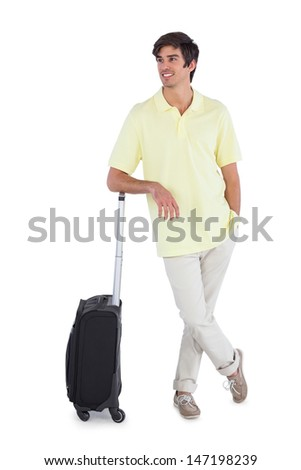 Happy man standing with his suitcase on a white background