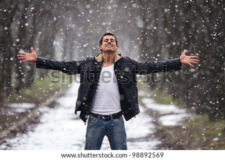 happy man staying under the snow - stock photo