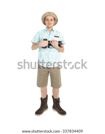 Happy man tourist in blue shirt brown shorts and hat with dslr camera. Traveler going to photo tour. Isolated on white background. Interesting trip on summer vacation.