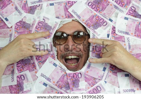 happy man under a bed of euro notes - stock photo
