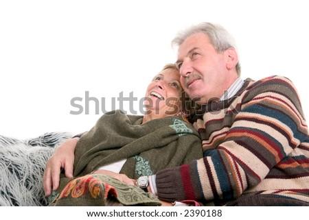 Happy man wearing sweatshirt embracing woman in her fifties - stock photo
