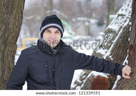 Happy man wearing winter clothes on a cold day - stock photo