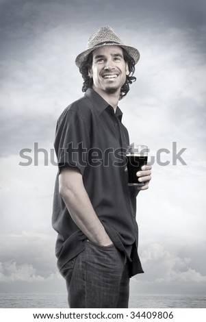 Happy man with a beer - stock photo