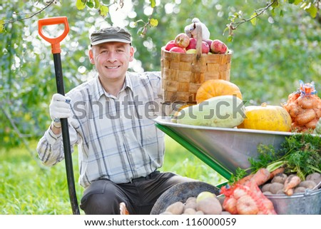 happy man with a crop in the garden - stock photo