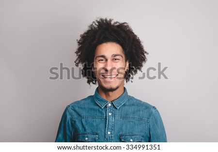 Happy man with afro with - stock photo