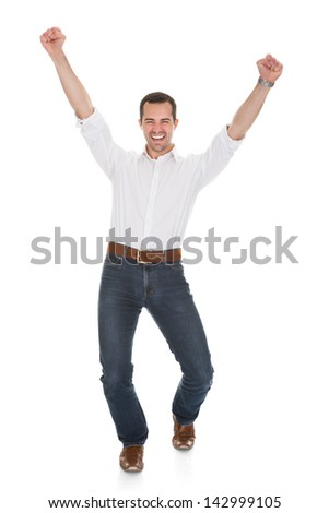 Happy Man With Arm Raised Over White Background - stock photo