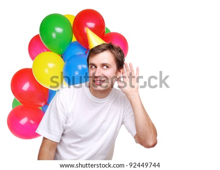 Happy man with balloons listening to the news - stock photo