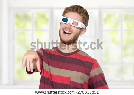 happy man with 3d movie glasses celebrating new movie - stock photo