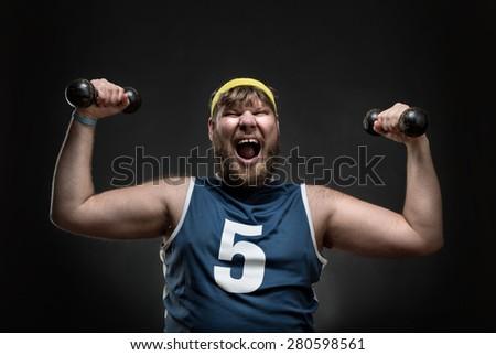 Happy man with dumbbells - stock photo