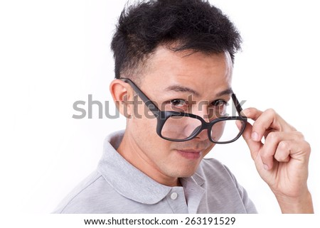 happy man with glasses looking at you through his eyeglasses - stock photo