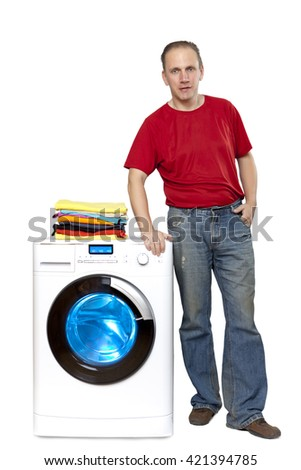happy man with new washing machine - stock photo