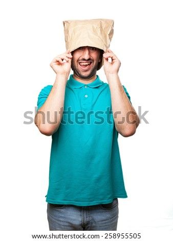 happy man with  paper bag in his head - stock photo