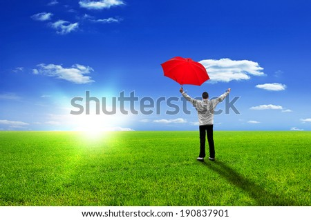 Happy man with red umbrella jubilates - enjoying life