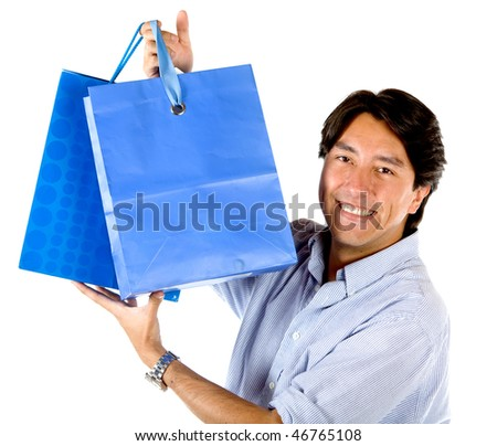 Happy man with shopping bags isolated over a white background