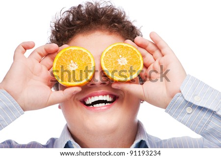 Happy man with slices of orange on his eyes, isolated on white background