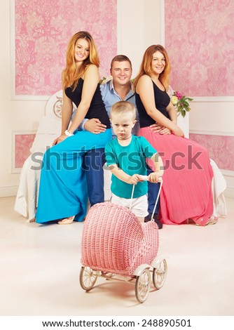 happy man with two women and resentful child - stock photo