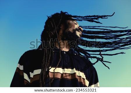 "Happy man with ""windy"" dreadlocks. Caribbeans. - stock photo"