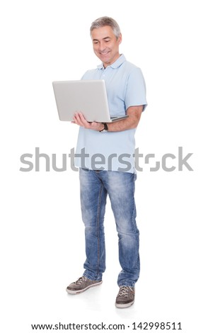 Happy Man Working On Laptop Isolated Over White Background - stock photo