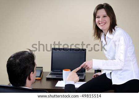 happy manager communicating with her chief - stock photo