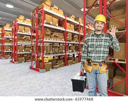 happy manual worker in classic warehouse 3d background - stock photo