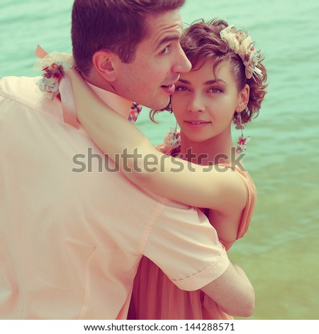 Happy marriage concept. Portrait of a beautiful couple of hipsters in trendy clothing. Wedding day. Close up. Vintage style. Outdoor shot